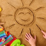 Beach with smiling sun